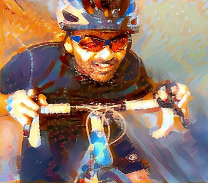 Tony Adams riding crouched down on road bike smiling for the smart ride Florida key west